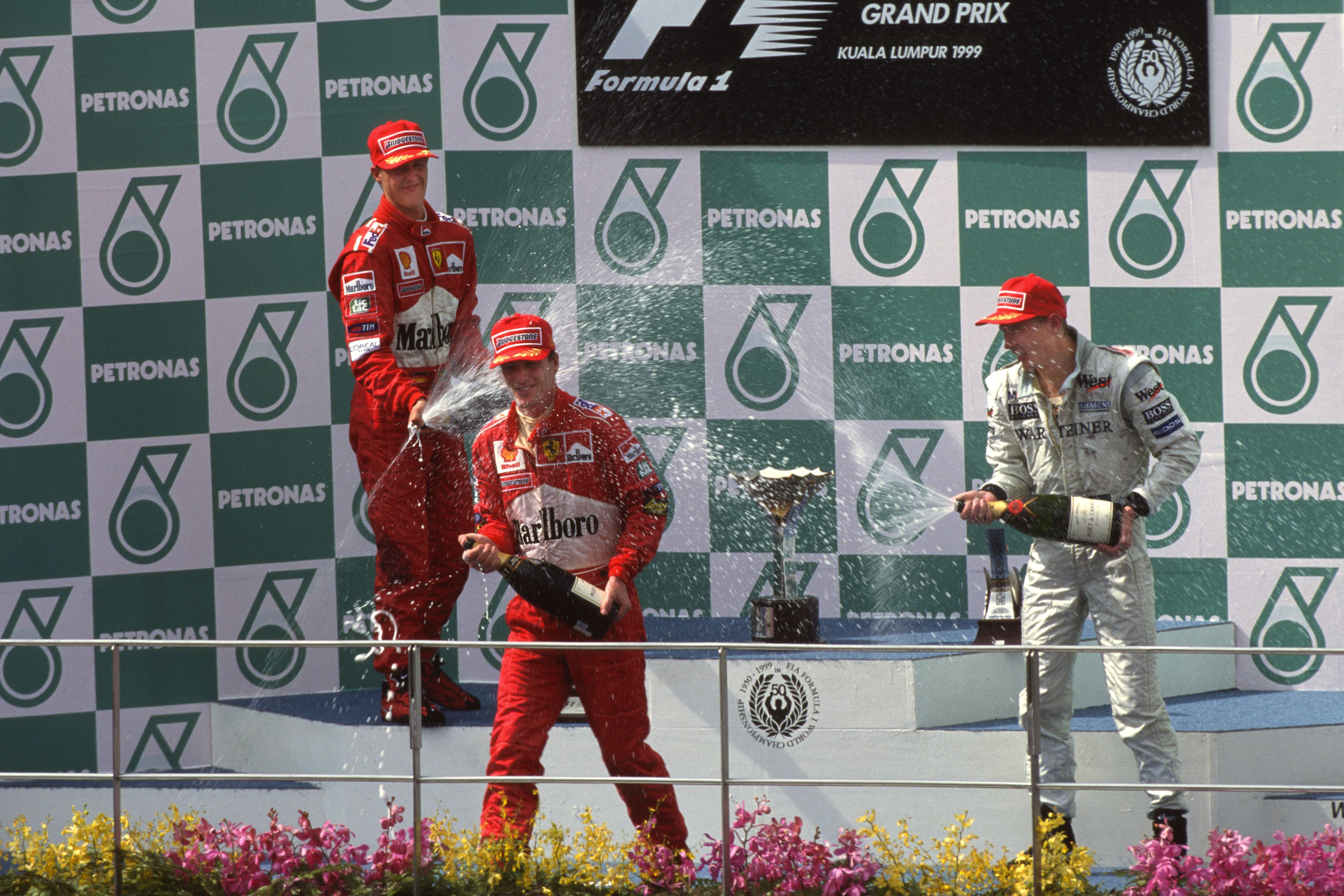 1999 Malaysian GP podium Eddie Irvine Michael Schumacher Mika Hakkinen F1 Ferrari McLaren Sepang